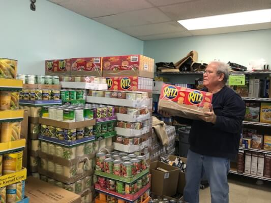 Stocking the food pantry store